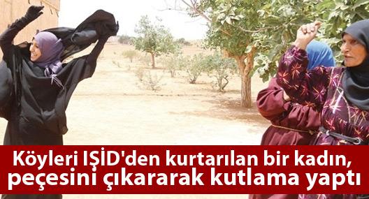 Köyleri IŞİD'den kurtarılan bir kadın, peçesini çıkararak kutlama yaptı
